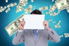 Составное изображение бизнесмена держа пустой знак перед его головой Стоковое фото RF