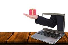Составное изображение бизнесмена держа руку вне в представлении Стоковые Фотографии RF