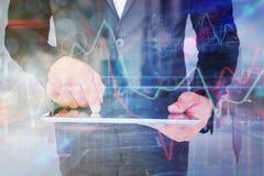 Составное изображение бизнесмена используя его ПК таблетки Стоковое Изображение RF