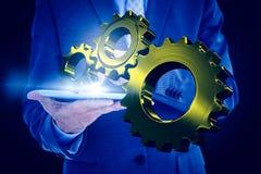 Составное изображение бизнесмена используя ПК таблетки Стоковые Фотографии RF