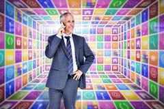 Составное изображение бизнесмена на телефоне Стоковые Фотографии RF
