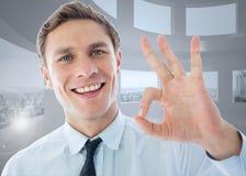 Составное изображение бизнесмена показывая одобренный знак Стоковые Изображения