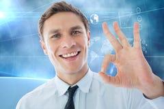 Составное изображение бизнесмена показывая одобренный знак Стоковая Фотография RF
