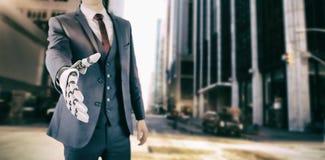 Составное изображение бизнесмена при робототехническая рука причаливая для рукопожатия Стоковая Фотография RF