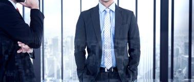 Составное изображение бизнесмена смотря камеру Стоковые Изображения RF