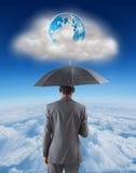 Составное изображение бизнесмена стоя под зонтиком Стоковые Фото