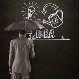 Составное изображение бизнесмена стоя под зонтиком Стоковое Фото