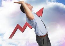 Составное изображение бизнесмена стоя с руками вверх Стоковые Фото