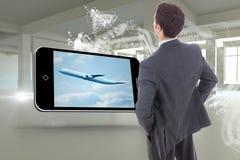 Составное изображение бизнесмена стоя с руками на бедрах Стоковые Изображения