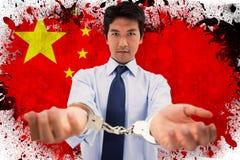 Составное изображение бизнесмена с наручниками Стоковое Изображение RF