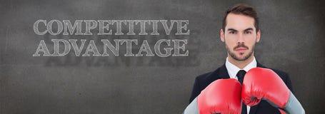 Составное изображение бизнесмена с перчатками бокса Стоковые Фото