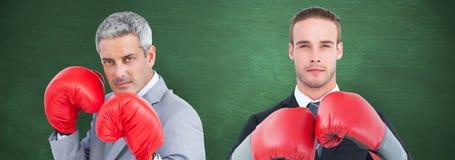 Составное изображение бизнесмена с перчатками бокса Стоковые Фотографии RF
