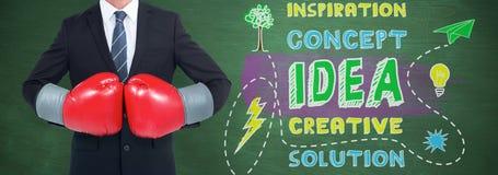 Составное изображение бизнесмена с перчатками бокса Стоковые Изображения RF