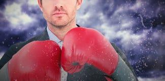 Составное изображение бизнесмена с перчатками бокса Стоковое фото RF