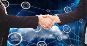 Составное изображение бизнесмена тряся руки с коллегой Стоковое фото RF