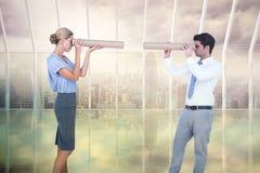 Составное изображение бизнесменов смотря один другого Стоковые Изображения