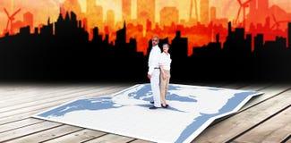 Составное изображение бизнесменов стоя спина к спине Стоковая Фотография