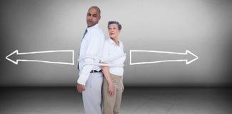Составное изображение бизнесменов стоя спина к спине Стоковое фото RF