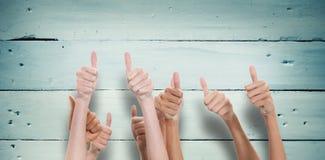 Составное изображение больших пальцев руки поднятых и рук вверх Стоковые Фото