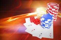 Составное изображение взгляда высокого угла знаков внимания казино с костью и играя карточками Стоковые Фотографии RF