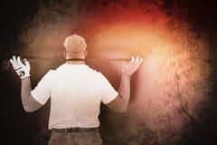 Составное изображение вид сзади игрока гольфа держа гольф-клуб Стоковые Изображения RF