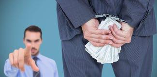 Составное изображение вид сзади бизнесмена с наручником и деньгами Стоковые Фото
