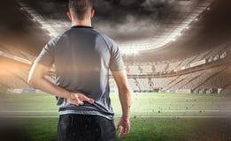 Составное изображение вид сзади игрока рэгби при пересеченные пальцы Стоковые Фото