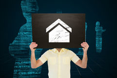 Составное изображение вскользь человека показывая доску Стоковые Изображения