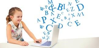Составное изображение девушки используя компьтер-книжку на таблице Стоковое фото RF