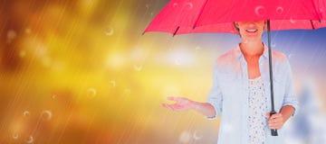 Составное изображение женщины держа зонтик Стоковая Фотография