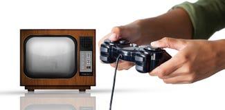 Составное изображение женщины играя видеоигру против белой предпосылки стоковая фотография rf