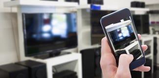 Составное изображение женщины используя ее мобильный телефон Стоковая Фотография