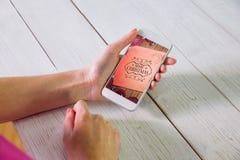 Составное изображение женщины используя smartphone Стоковое фото RF