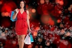 Составное изображение женщины стоя с хозяйственными сумками Стоковое фото RF