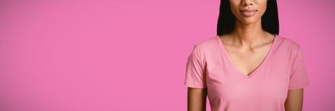Составное изображение женщин в розовом положении для рака молочной железы стоковая фотография rf