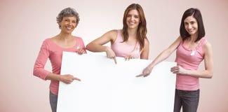 Составное изображение женщин в розовых обмундированиях держа доску для осведомленности рака молочной железы Стоковая Фотография RF