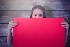 Составное изображение женщин держа пустой плакат красный Стоковые Изображения RF