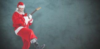 Составное изображение жизнерадостного Санта Клауса играя гитару Стоковые Фото