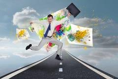 Составное изображение жизнерадостного скача бизнесмена с его чемоданом Стоковые Изображения