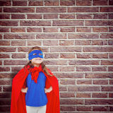 Составное изображение замаскированной девушки претендуя быть супергероем Стоковая Фотография RF
