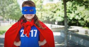Составное изображение замаскированной девушки претендуя быть супергероем Стоковое Фото