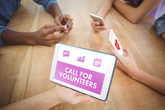 Составное изображение зеленого звонка для волонтеров стоковые изображения rf