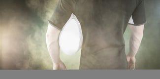 Составное изображение игрока рэгби держа шарик рэгби Стоковое фото RF