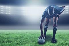 Составное изображение игрока рэгби принимая положение и 3d Стоковые Изображения