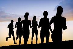 Составное изображение идущих силуэтов Стоковые Изображения