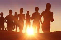 Составное изображение идущих силуэтов Стоковые Фото