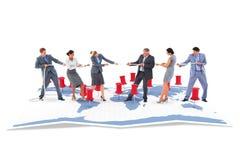 Составное изображение команды дела вытягивая веревочку Стоковое Изображение RF