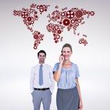 Составное изображение коммерсантки имея телефонный звонок пока ее представлять коллеги Стоковое Фото