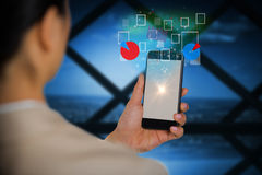 Составное изображение коммерсантки используя мобильный телефон Стоковое фото RF