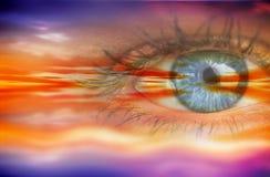 Составное изображение конца вверх женского голубого глаза Стоковые Фото